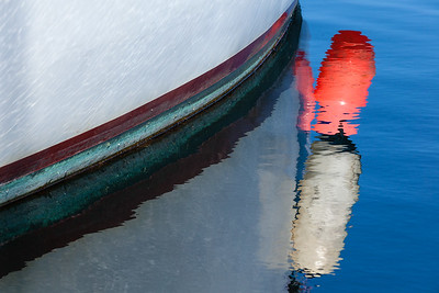 Boat, buoys and reflections.