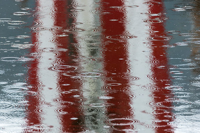 Flag reflection and raindrops.