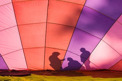 Silhouettes in a hot air balloon.