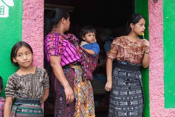 Traditionally dresses Guatemalan women in a shop doorway.