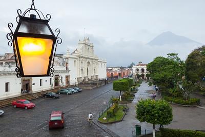 View of plaza and church and volcano, Antigua, Guatemala.