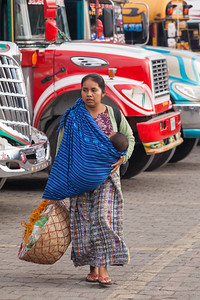 Multitasking - breastfeeding and walking to market, Guatemala.