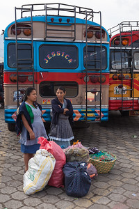 Women waiting for the bus, Antigua, Guatemala.