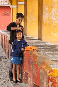 Sisters fixing hair, Guatemala.