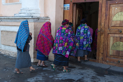 Women walking into church, Guatemala.