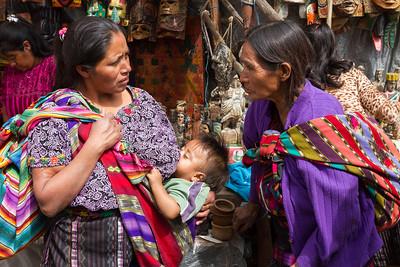Breastfeeding while socializing at the market.