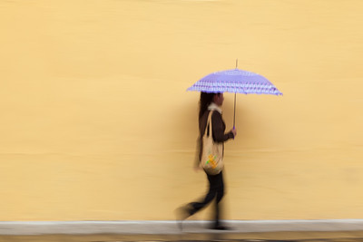 Woman with umbrella in motion, Guatemala.
