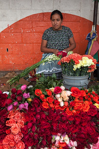 Woman selling roses in market.