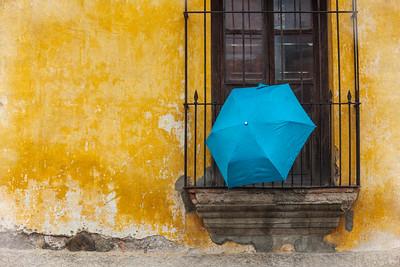 Blue Umbrella, Yellow Wall.