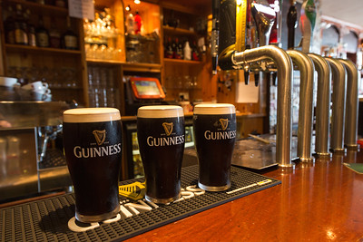 Pints of Stout on a bar, Allihies, Ireland.
