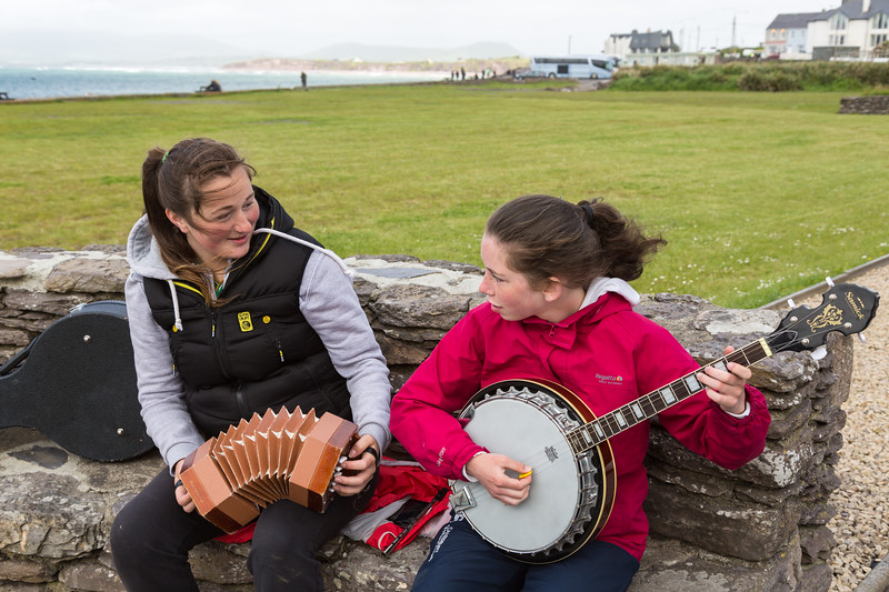 Young girls play music for tourists, Derrynane Bay, Ireland.