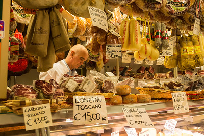 Butcher shop in marketplace, Italy.
