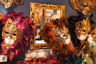 Mask artist in her studio, Venice, Italy.