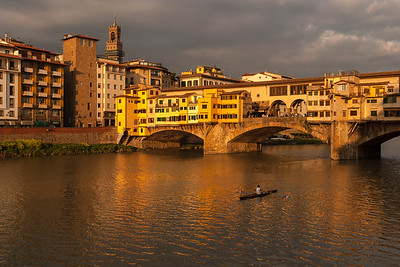 Rowing on the River Arno, Florence, Italy.
