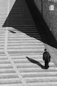 Friar and shadows, Assisi, Italy.