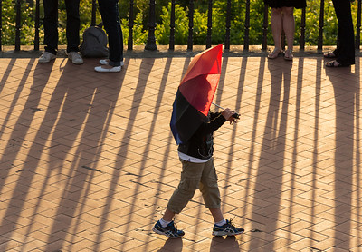 Boy with red umbrella