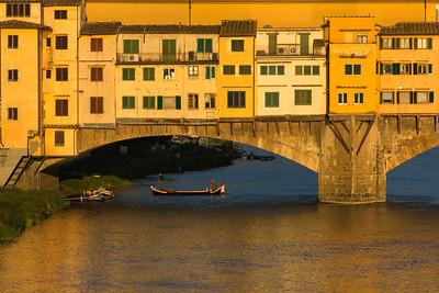 Sunset light on Ponte Vecchio bridge and Arno river.