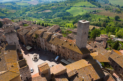 Overhead view of San Gimignano village and surrounding fields, Italy.