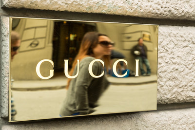 Reflection in Gucci sign.
