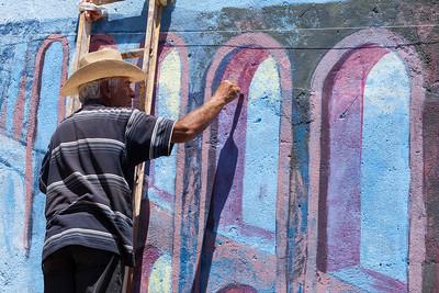 Mural artist at work.