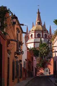 Imposing church domes over a village street, San Miguel de Allende.