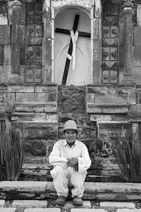Mexican farmer and old church altar.
