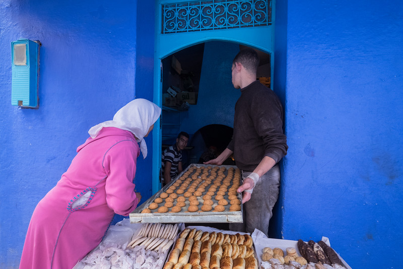 Baking pastries at communal oven, Chefchaouen, Morocco.