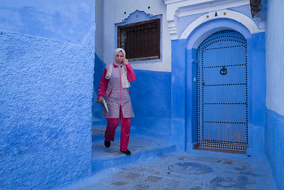 Woman in pink surround by blue.