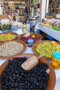Olives for sale in an outdoor Moroccan shop.