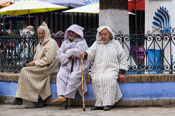 Elderly men relaxing in town, Chefchaouen.