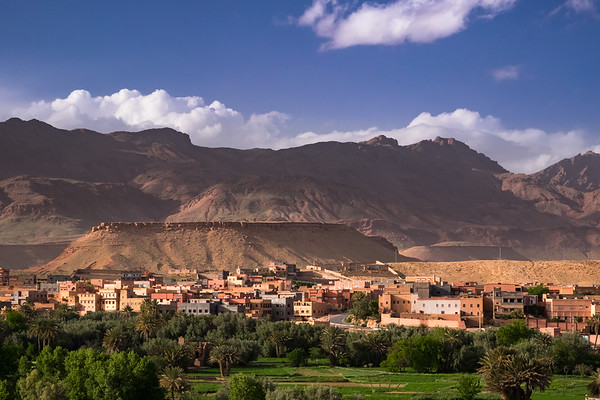Africa, Morocco. The oasis city of Tinerhir sits beneath foothills of the Atlas mountains.