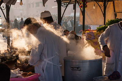 Men cooking in Jemaa El Fna, Marrakesh, Morocco.