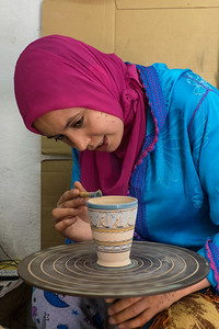 Painting the glaze, Fes, Morocco.