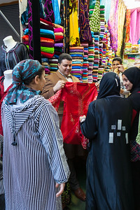 Women shop for caftain, Morocco.