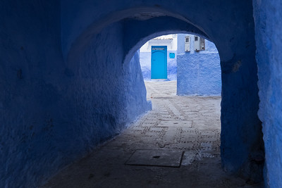Africa, Morocco. A blue alley and door in the hilltown of Chefchaouen.