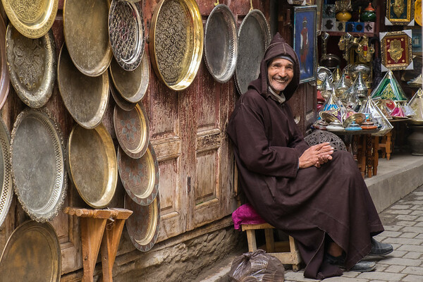 Africa, Morocco, Fes. A happy salesclerk of a brass shop in the medina.