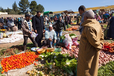 Men selling produce, Morocco.