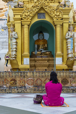 Praying before Buddha, Myanmar.
