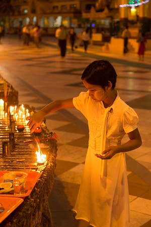 Lighting the candles, Myanmar.