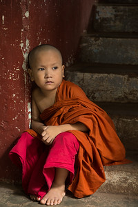 Pensive child monk, Myanmar.