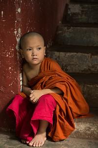 Pensive child monk, Myanmar.