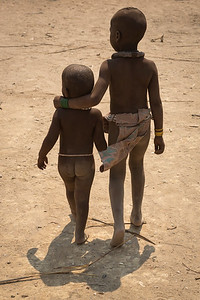 Young Himba boy with arm around younger child.