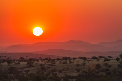 Red Ball of Sun over land, Namibia.