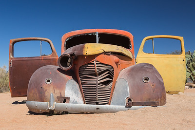 Rusty old car in Sand, Namibia.