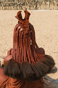 Unusual hair of a Himba woman, Namibia.
