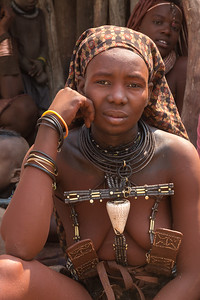 Africa, Namibia. Portrait of a young Himba woman with traditional necklaces that indicate she is married.