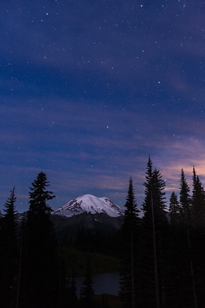 Moonlight and stars over Mt. Rainier.