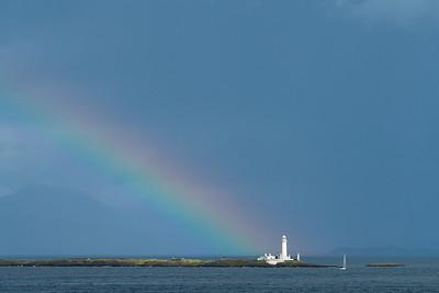 Rainbow over Eilean Musdile Lighthouse, Scotland.