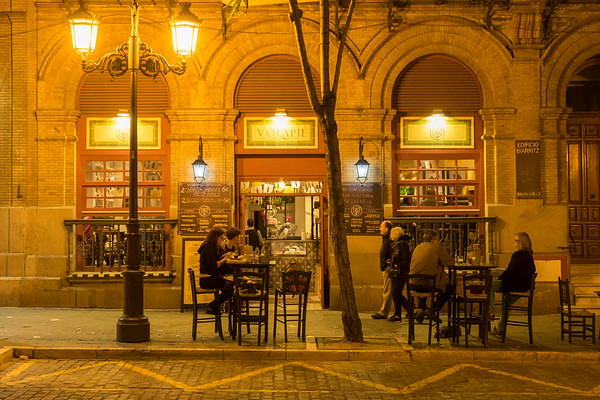 Dining late outdoors in Seville.