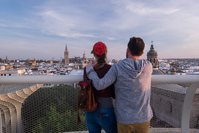 A couple shares the view of Seville.